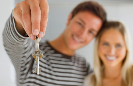 Happy couple holding keys