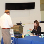 Adam bought a lot of tickets - and definitely didn't go home empty handed! Kelli Steigenberger sells Adam his tickets.