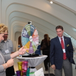 MGIC's Kim Schauer and Jack Long invite attendees to spin the wheel at their booth.