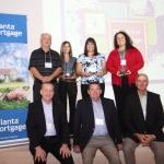 Inlanta Mortgage Senior Management Team poses with the 10 year anniversary award recipients.