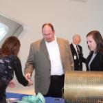 Roy Pointer and Julia Bearden from Kearney, Missouri grab some raffle tickets.