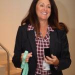 Cindy Laffey wins the diamond solitaire necklace.