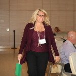 Lori Jasicki is called to the front of the room - its her turn to play the game!